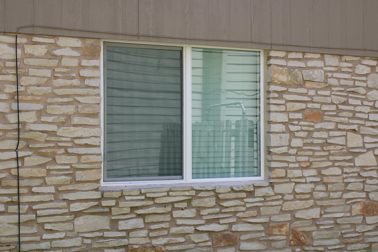 round rock home with replacement encompass series windows