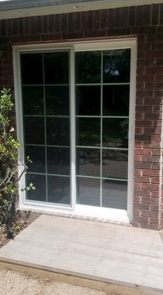 Exterior view of new white vinyl sliding patio door