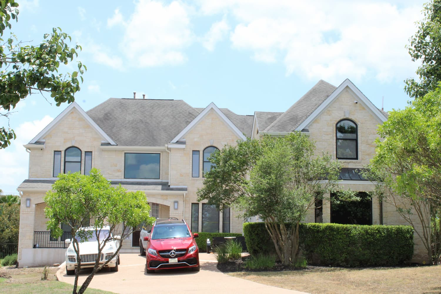 wide exterior shot of Austin home with replacement Pella windows and doors