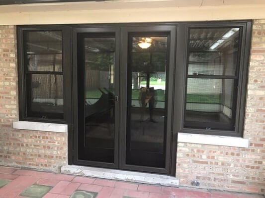after image of chicago home with new wood double hung windows & hinged patio door