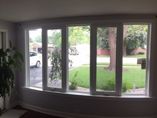 interior of chicago home with new casement windows in bow window
