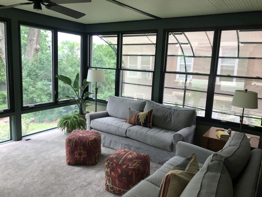 Couches on sun porch with new wood double-hung and casement windows