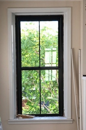 fiberglass double-hung window on historic building