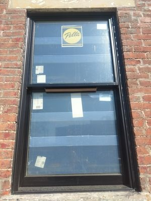 double-hung wood window replacement on historic building renovation