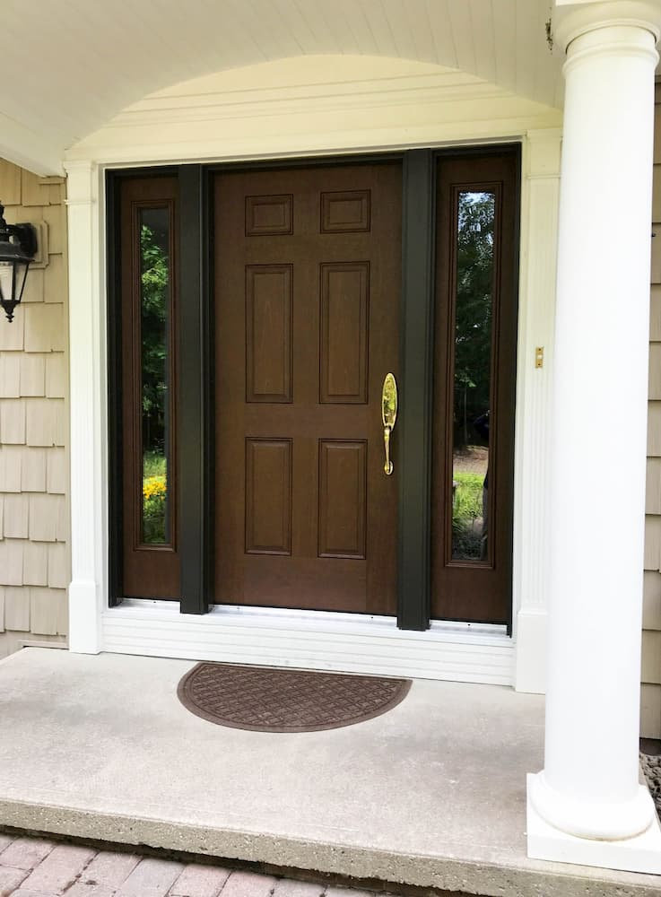 New wood-look 6-panel fiberglass entry door with sidelights