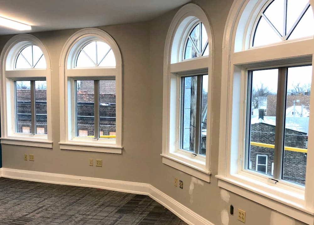 Interior view of new wood casement and half-arch windows