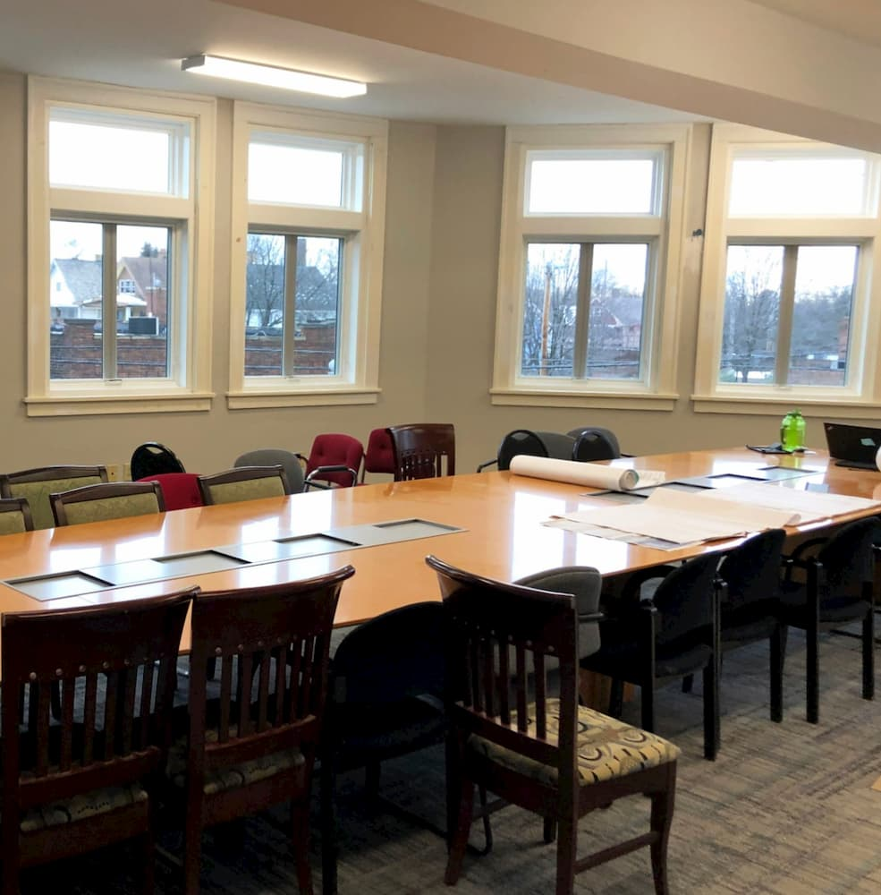 Board room with new wood casement and awning windows