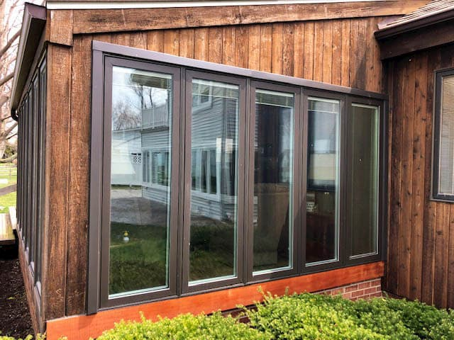 New Pella wood casement windows with brown exterior finish