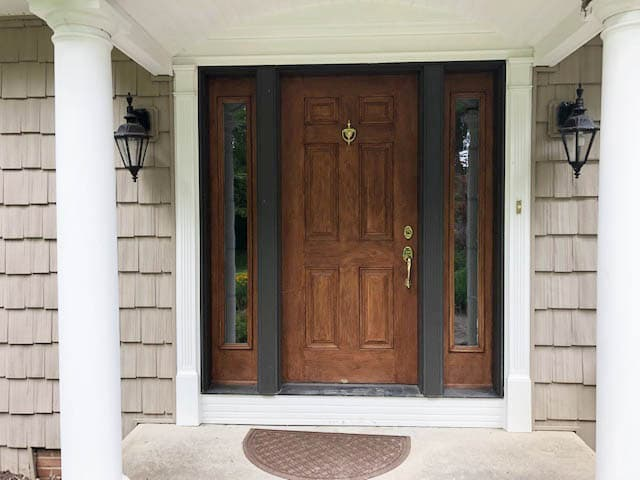 Old wood six-panel entry door with sidelights