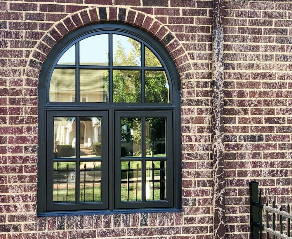 New black casement windows on brick home
