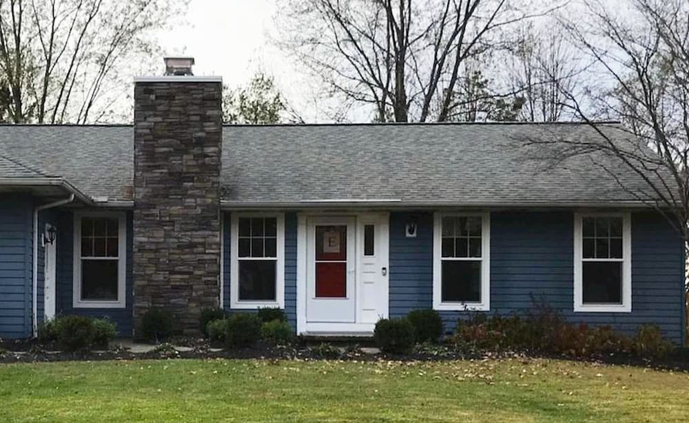 Front exterior of blue home with all-new double-hung windows