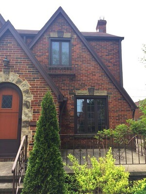 cleveland home gets new wood casement windows and fiberglass entry door