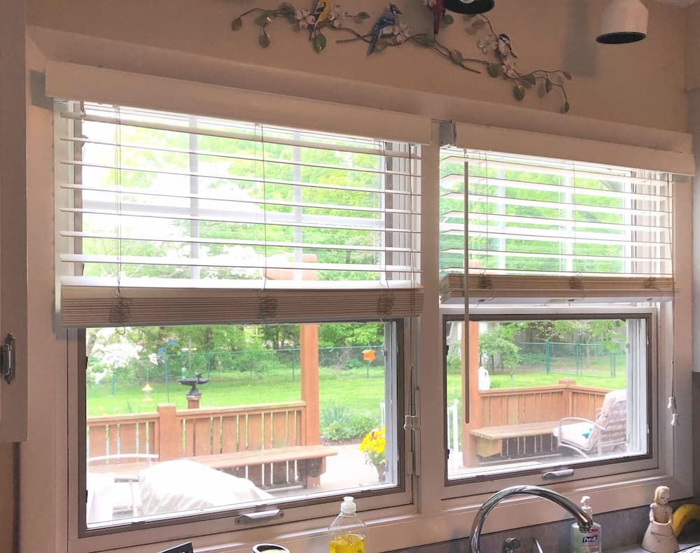 Two old single-hung windows over a kitchen sink