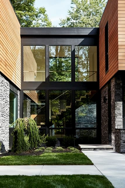 Front entry with contemporary wood windows