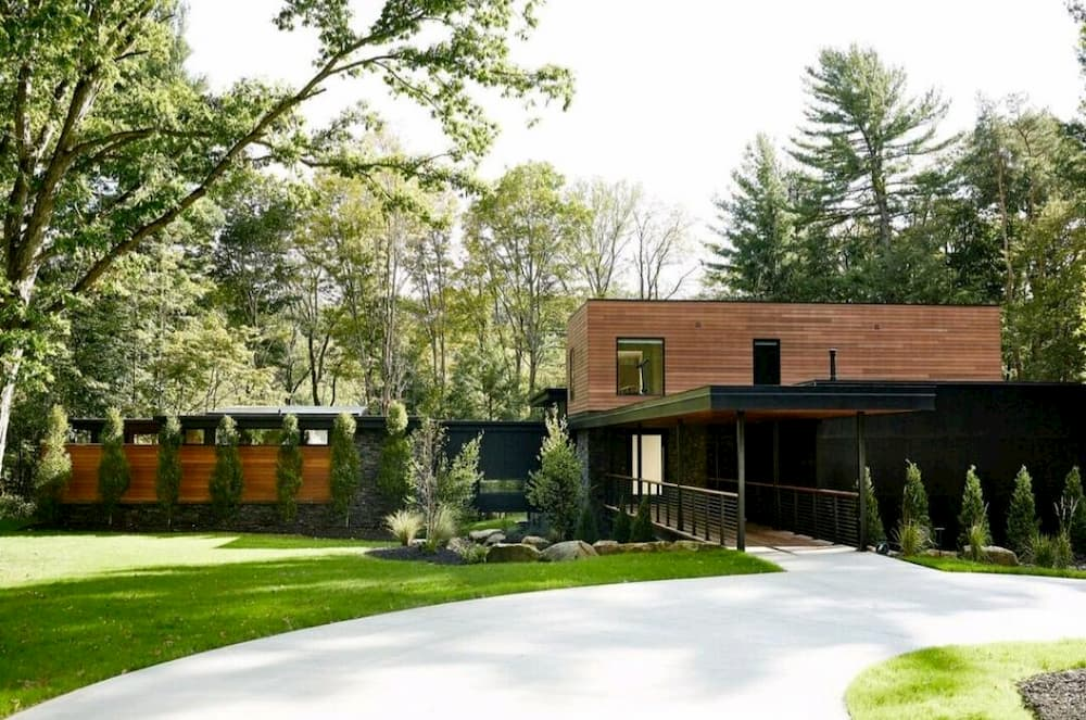 Front exterior of modern home with contemporary black windows