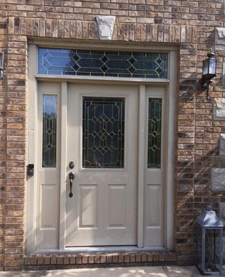 before image of cleveland home with new fiberglass entry door