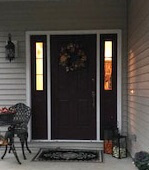 before image of mentor home with new fiberglass entry door