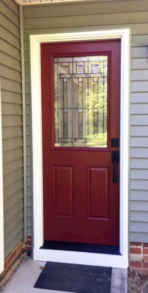 New red fiberglass entry door with art glass