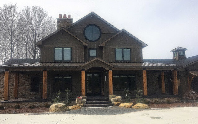 new construction home with specialty wood windows