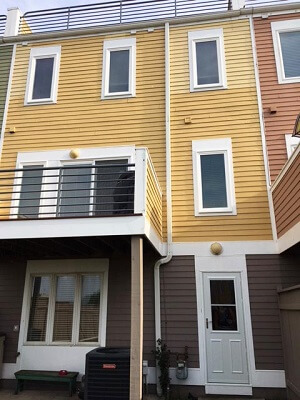 three level townhome gets new vinyl casement windows