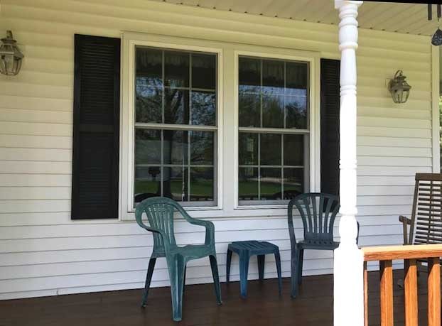 vinyl double-hung window replacement on porch
