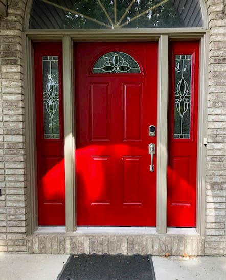 Red fiberglass entry door system with decorative glass