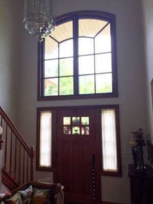 interior view of new wood windows above entry door