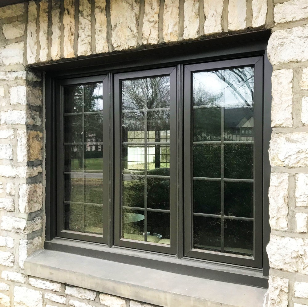 Bexley Ohio home black casement wood windows with traditional grilles