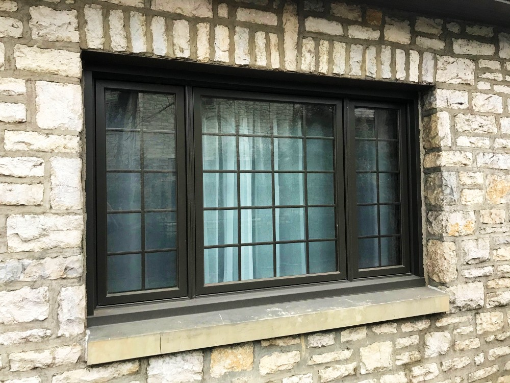 Bexley Ohio home black casement windows with traditional grilles