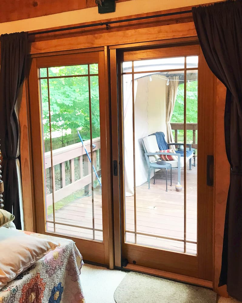 Interior view of wood sliding patio door with prairie-style grille pattern