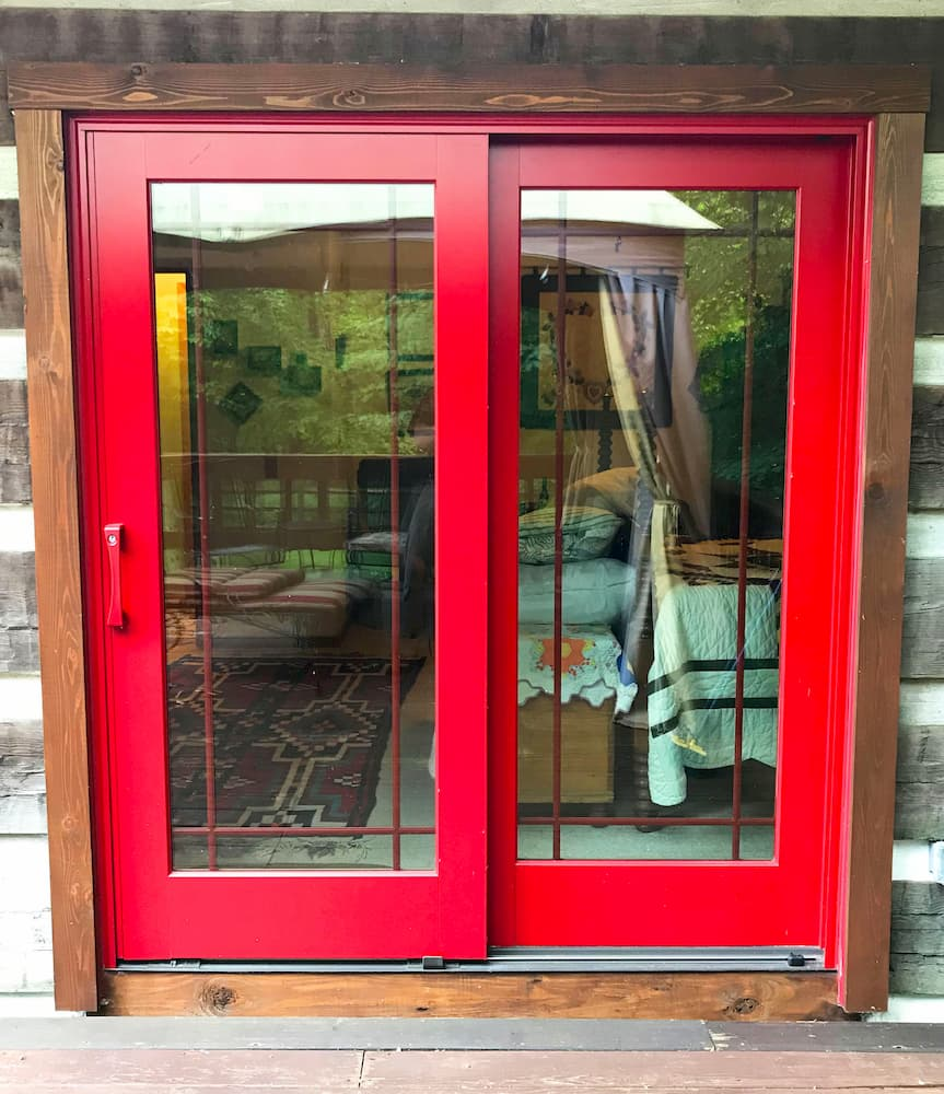 Exterior view of wood sliding patio door with a cherry red finish