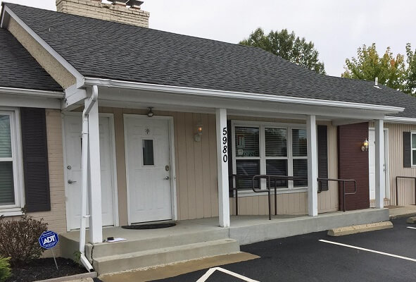 before image of columbus chiropractic office with new fiberglass entry door