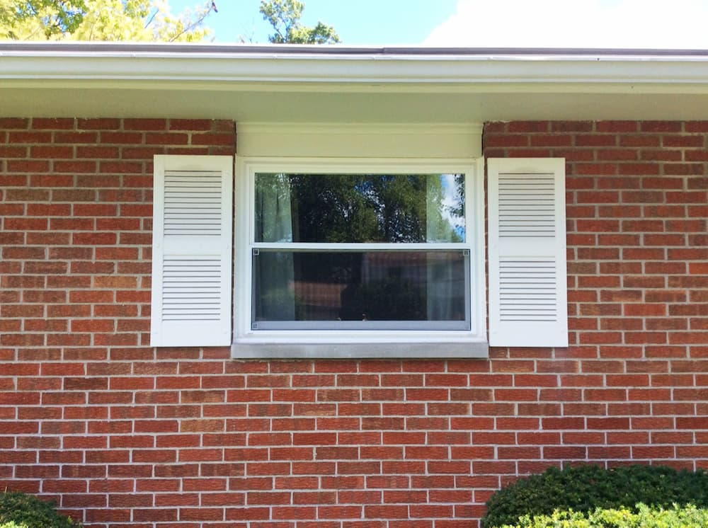 New vinyl double-hung window on a red brick home