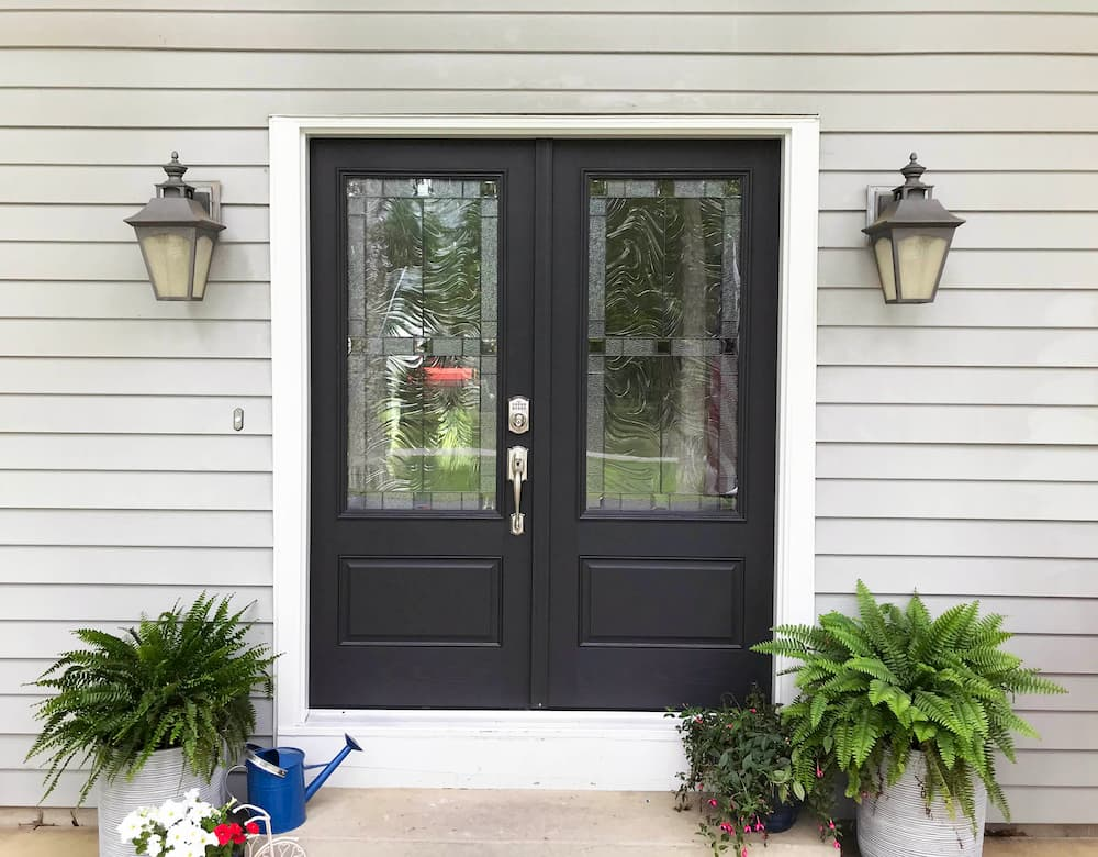 New black fiberglass double entry doors with decorative glass