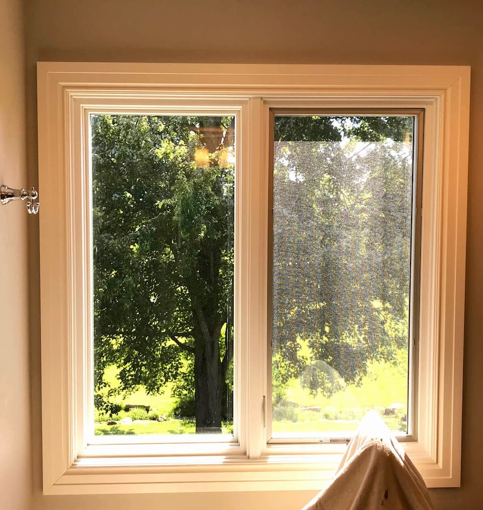 Interior view of new wood side-by-side casement windows