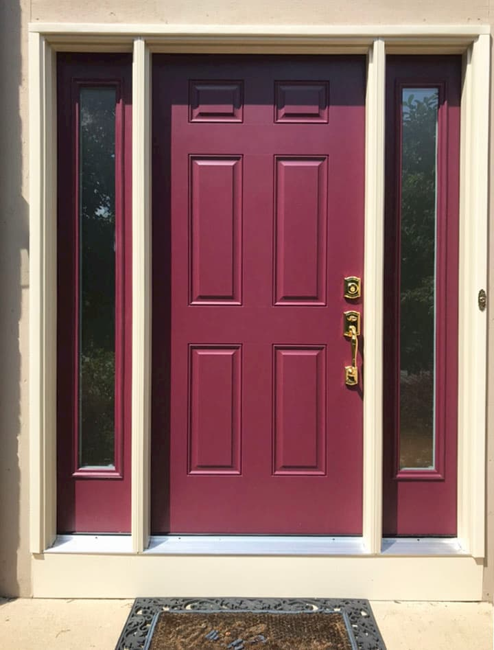 New fiberglass entry door with full-length sidelights in a cranberry color