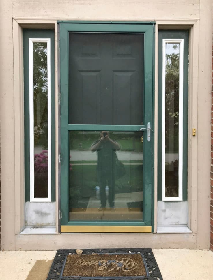 Green entry and storm doors with full-length sidelights