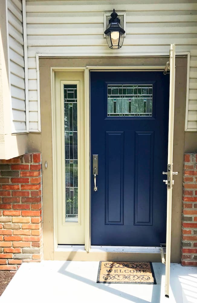 New blue fiberglass entry door with statement glass sidelight