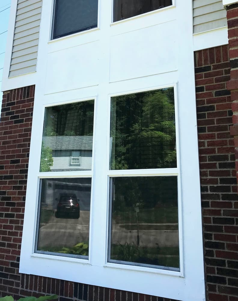 Exterior view of 4 new vinyl double-hung windows