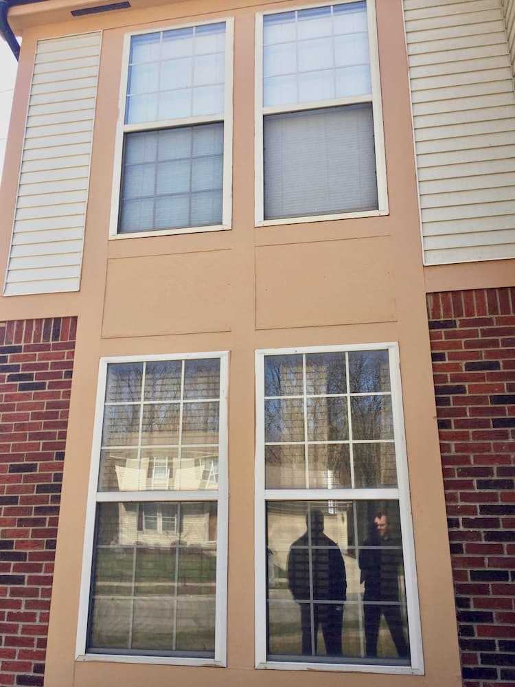 Exterior view of 4 old double-hung windows