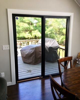new black fiberglass sliding patio door