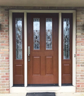 mahogany grain fiberglass entry door in Columbus