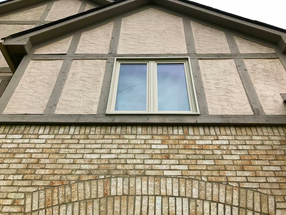 Two new vinyl casement windows in an almond exterior finish