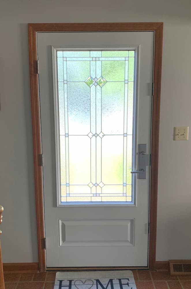 Interior view of new fiberglass entry door with decorative glass panel