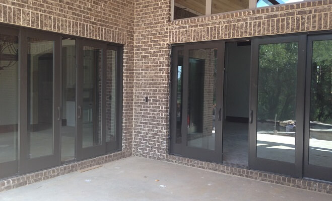Black Sliding Patio Doors Give Easy Patio Access for Dallas Home