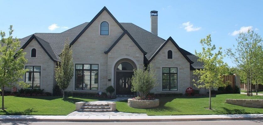 Wood single-hung windows with grills blend traditional and modern styles