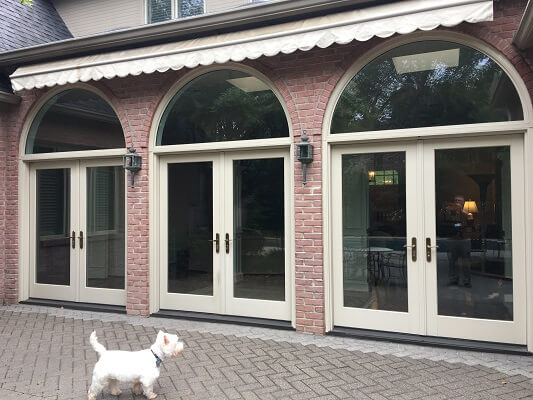dallas home gets new wood hinged patio doors outside view