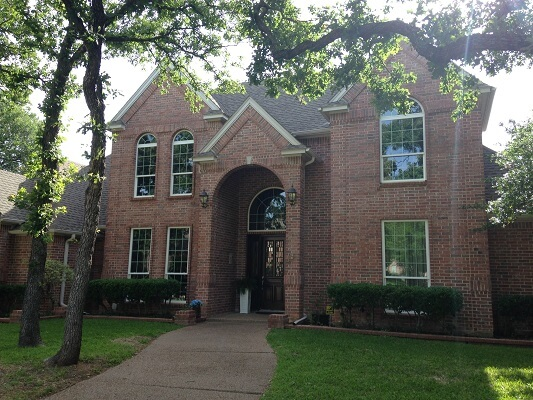 front image of dallas home with new single hung vinyl windows