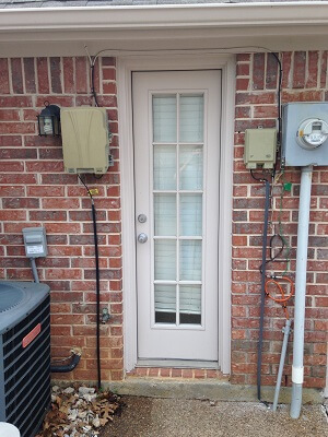side door image of dallas home with new vinyl single hung windows