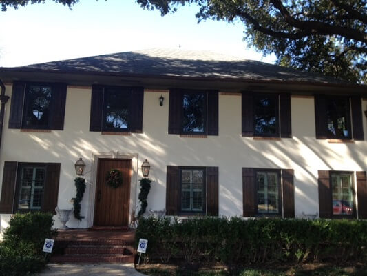home in dallas gets new wood casement windows and entry door after photo